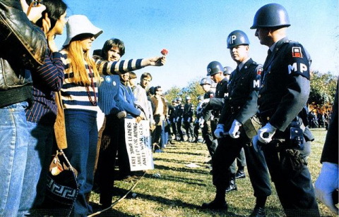 1-Flower_Power_A_demonstrator_offers_a_flower_to_military_police_at_an_National_Mobilization_Committee_to_End_the_War_in_Vietnam_sponsored_protest_in_Virginia_1967