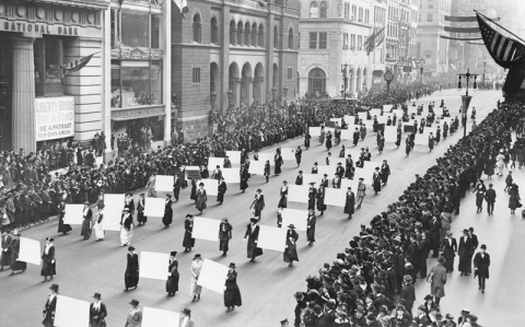Womens_suffragists_parade_in_New_York_City_in_1917_carrying_placards_with_signatures_of_more_than_a_million_women